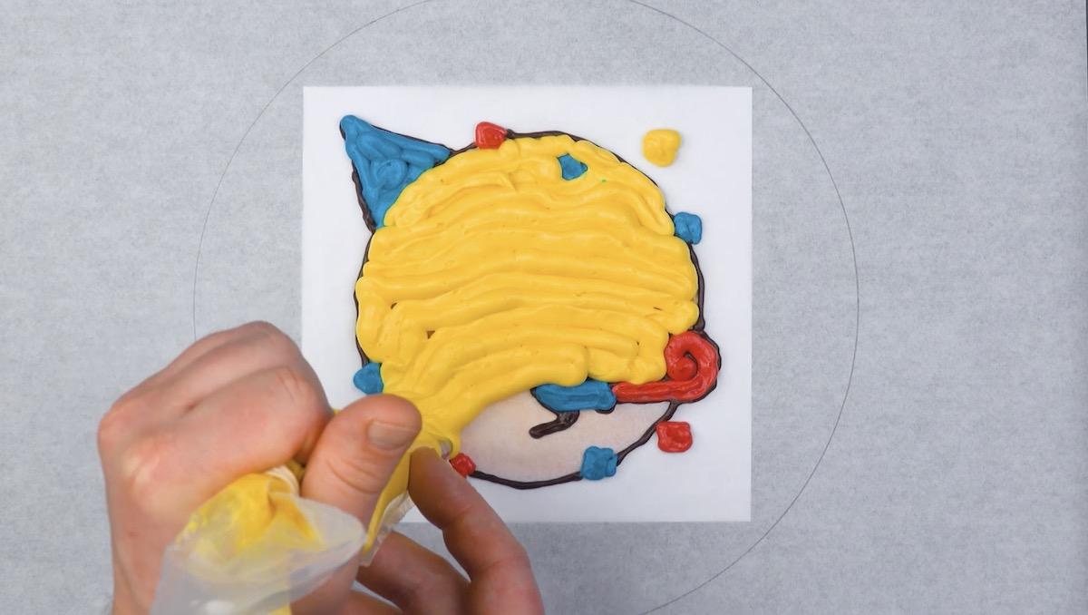 dessiner le smiley avec du glaçage coloré