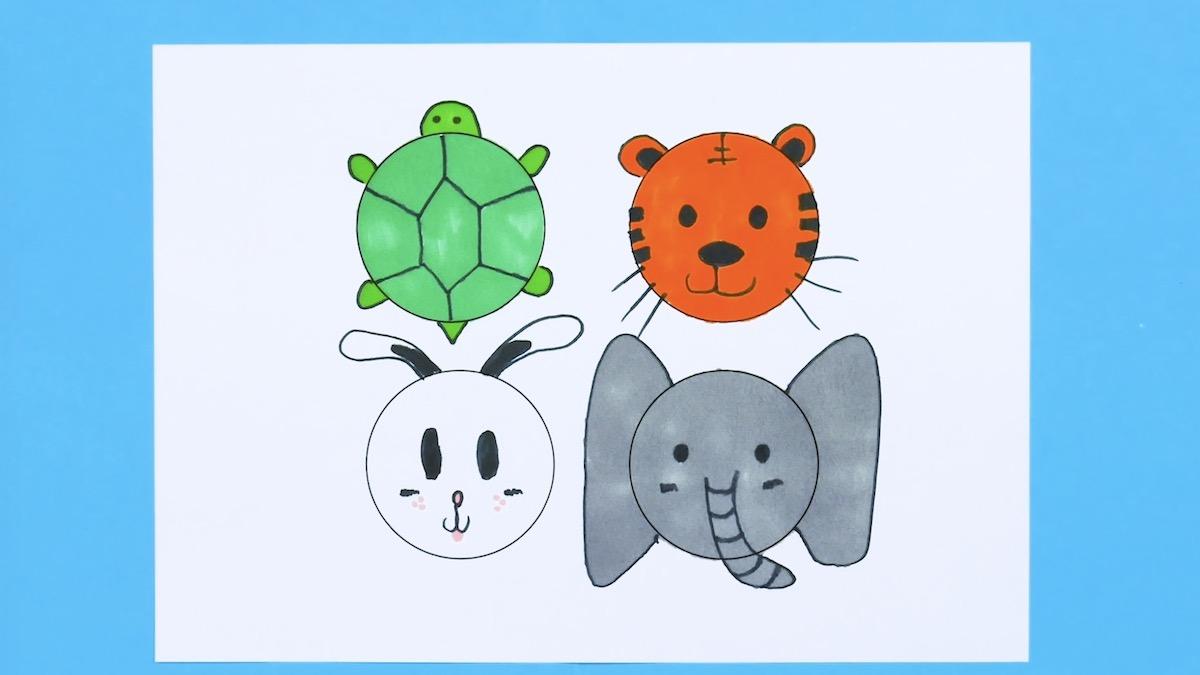 tortue, tigre, lapin et éléphant dessinés sur une feuille de papier