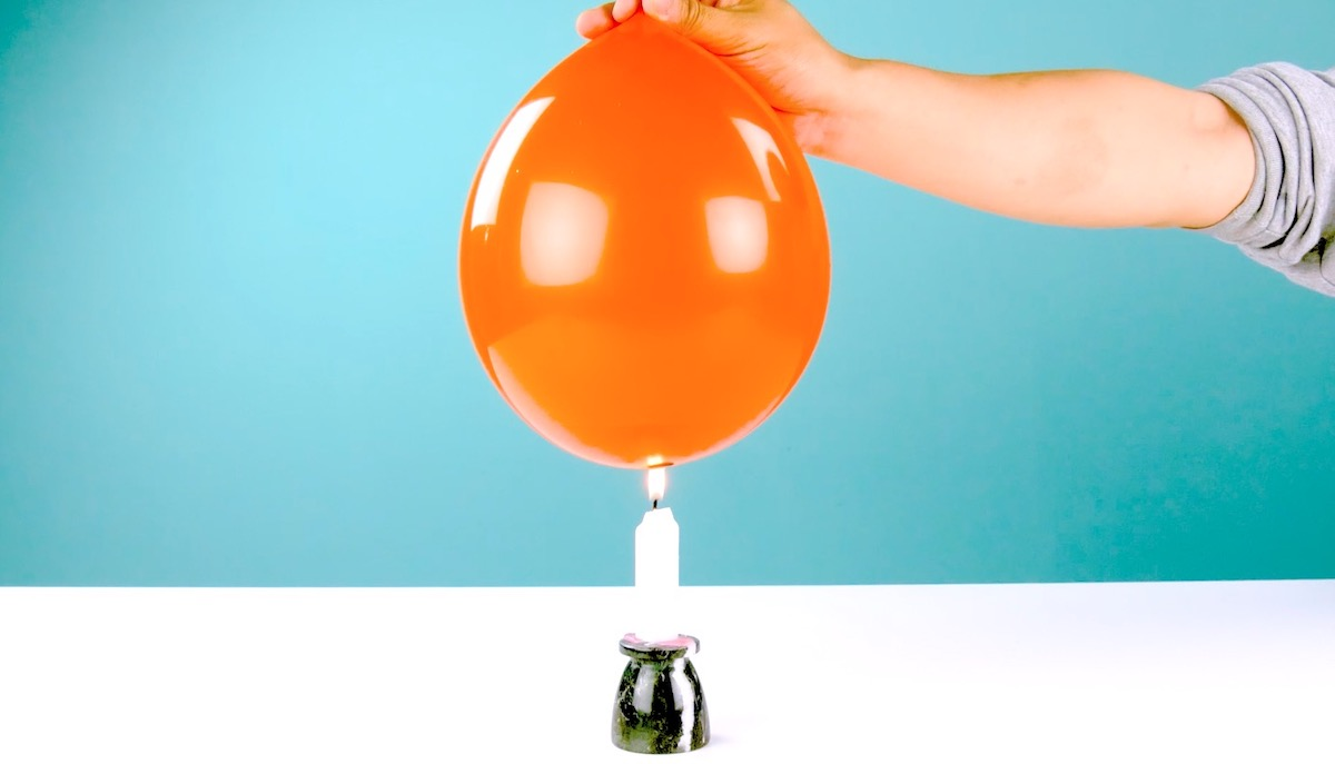 put a little water in a balloon to make it fireproof