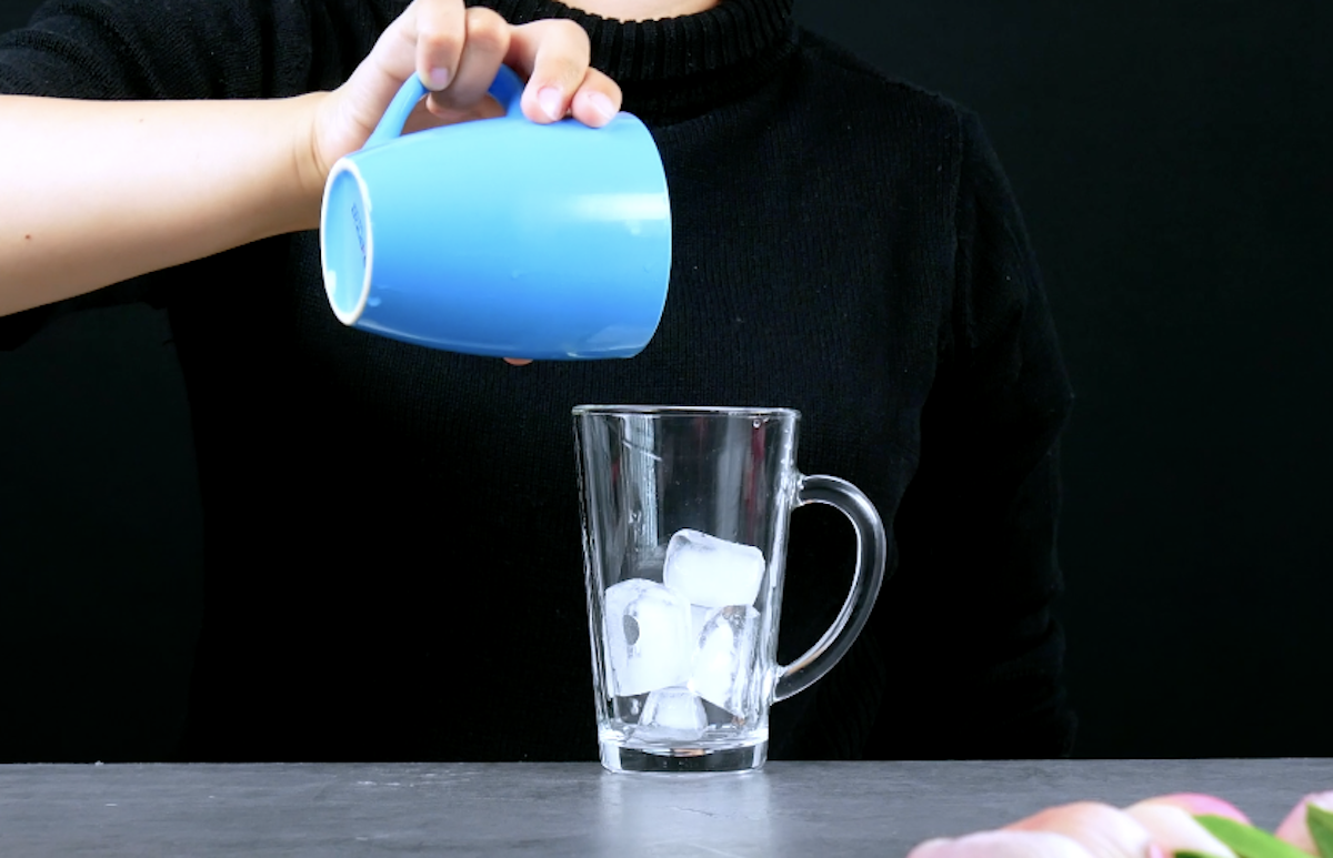 pour the ice cubes into the glass