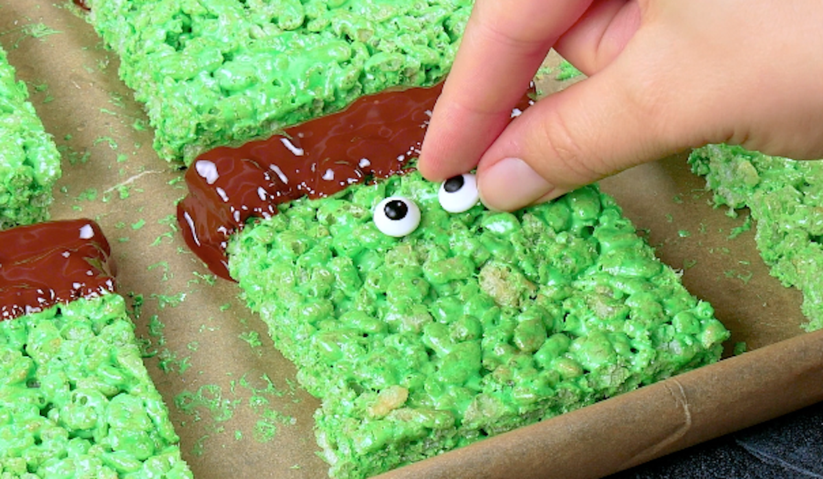 dip the rectangles in the chocolate and add the eyes