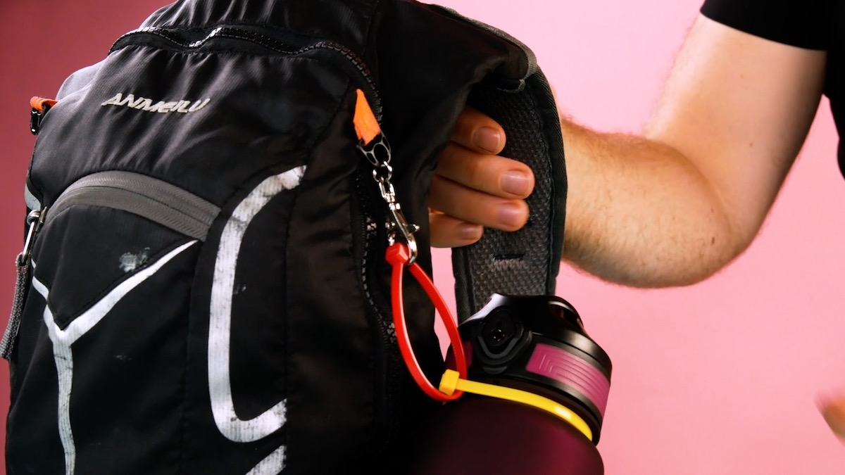 Secure a water bottle to the backpack with cable ties