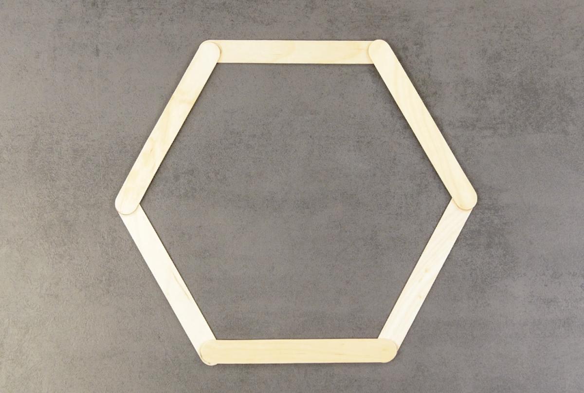 form a hexagon with ice cream sticks