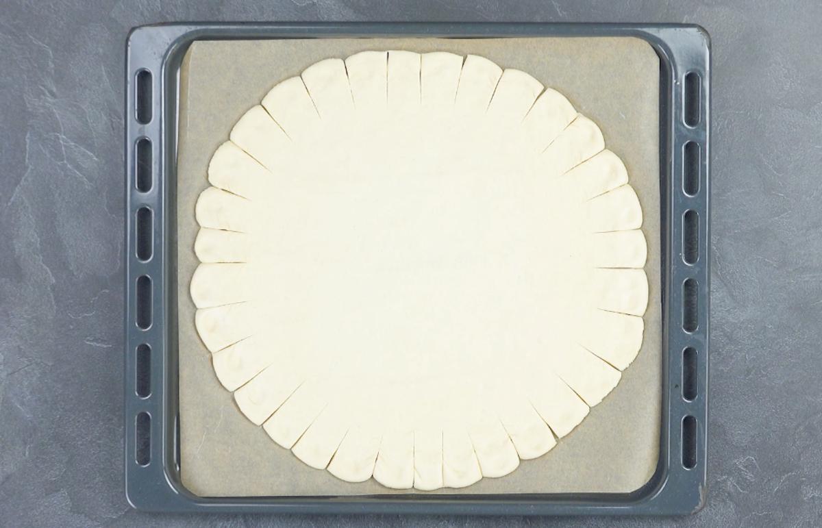 étaler la pâte à pizza